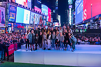 New York, NY - May 23, 2019:  Members of the USWNT watch as billboards across Times Square are filled with images of the team.