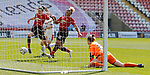 The ball flies across the goal for Lizzie Arnot of Manchester United Women to tap in for the goal