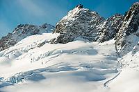 Fresh snow over deep crevasses on top of Fox Glacier, Westland Tai Poutini National Park, West Coast, UNESCO World Heritage, New Zealand, NZ
