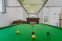 BNPS.co.uk (01202) 558833. <br /> Pic: ScottParry/BNPS<br /> <br /> Pictured: Games room. <br /> <br /> Life's a beach...<br /> <br /> A coastal clifftop home above a picturesque Cornish beach is on the market for £1.75m.<br /> <br /> High Seas sits in a prime position above Millendreath Beach in Looe, the 'Cornish Riviera', with spectacular views across Whitsand Bay and out to sea.<br /> <br /> The impressive five-bedroom property has almost 5,000 sq ft of living space and a decent sized garden, but it's real draw is its location.<br /> <br /> The house is 150 yards from Millendreath Beach and its garden gate will take the owners straight onto the South West Coast Path.