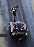 Jun 17, 2016; Bristol, TN, USA; Crew chief Terry Haddock with NHRA funny car driver Jim Campbell during qualifying for the Thunder Valley Nationals at Bristol Dragway. Mandatory Credit: Mark J. Rebilas-USA TODAY Sports