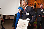Councillor Robert Davis, Deputy Leader, Westminster City Council, receives a gift at Tyburn Convent.  Restoration of the Tyburn Tree Plaque at the junction of Edgware Road and Marble Arch, London.
