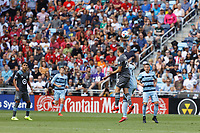 ST. PAUL, MN - AUGUST 21: Wil Trapp #20 of Minnesota United FC and Gadi Kinda #17 of Sporting Kansas City battle for the ball during a game between Sporting Kansas City and Minnesota United FC at Allianz Field on August 21, 2021 in St. Paul, Minnesota.