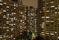AVAILABLE FROM PLAINPICTURE FOR COMMERCIAL AND EDITORIAL LICENSING.  Please go to www.plainpicture.com and search for image # p5690235.<br /> <br /> Apartment Buildings and Illuminated Windows on an Overcast and Misty Night, Upper West Side of Manhattan, New York City, New York State, USA