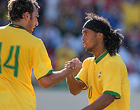 Brazil midfielder (10) Ronaldinho celebrates scoring with defender (14) Edu Dracena during an international friendly between the men's national team of Brazil and the USA at Soldier Field, Chicago, IL, on September 09, 2007. Brazil defeated 4-2.