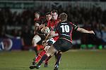 Denis Hurley takes on Lewis Robling..RaboDirect Pro12.Dragons v Munster.03.03.12.©STEVE POPE