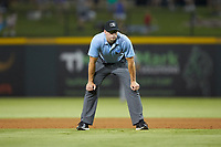 First base umpire Shane Livensparger works the International League game between the Scranton/Wilkes-Barre RailRiders and the Gwinnett Stripers at Coolray Field on August 16, 2019 in Lawrenceville, Georgia. The Stripers defeated the RailRiders 5-2. (Brian Westerholt/Four Seam Images)