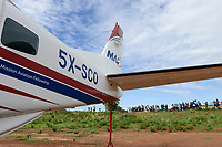UGANDA, Karamoja, Kaabong, Cessna aircraft of MAF Mission Aviation Fellowship, a airline for missionaries, NGO, humanitary aid / MAF Flugzeug auf dem airstrip