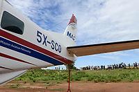 UGANDA, Karamoja, Kaabong, Cessna aircraft of MAF Mission Aviation Fellowship, a airline for missionaries, NGO, humanitary aid / MAF Flugzeug auf dem airstrip
