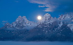 Wyoming, GTNP, Grand Teton National Park, Jackson. The setting moon over the Teton Range in the pre-dawn light.