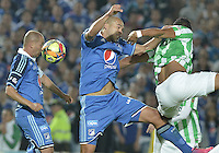 BOGOTÁ -COLOMBIA, 09-02-2014. Mayer Candelo (Izq.) y Andres Cadavid (C) jugadores de Millonarios saltan por el balón con Santiago Trellez (Der.) jugador de Atlético Nacional durante partido por la fecha 4 de la Liga Postobón  I 2014 jugado en el estadio Nemesio Camacho el Campín de la ciudad de Bogotá./ Mayer Candelo (L) and Andres Cadavid (C) players of Millonarios jumps for the ball with Santiago Trellez (R) player of Atletico Nacional during match for the 4th date of the Postobon  League I 2014 played at Nemesio Camacho El Campin stadium in Bogotá city. Photo: VizzorImage/ Gabriel Aponte / Staff