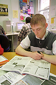 A young resident of Look Ahead Housing and Care's Bayswater hostel for the homeless looks through job adverts in the hostel's training room.