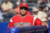 Batavia Muckdogs pitching coach Brendan Sagara (28) during a game against the State College Spikes on June 22, 2014 at Dwyer Stadium in Batavia, New York.  State College defeated Batavia 10-3.  (Mike Janes/Four Seam Images)