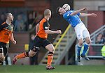 Dundee United v St Johnstone.....21.02.15<br /> Chirs Kane gets to the ball ahead of Jaroslaw Fojut<br /> Picture by Graeme Hart.<br /> Copyright Perthshire Picture Agency<br /> Tel: 01738 623350  Mobile: 07990 594431