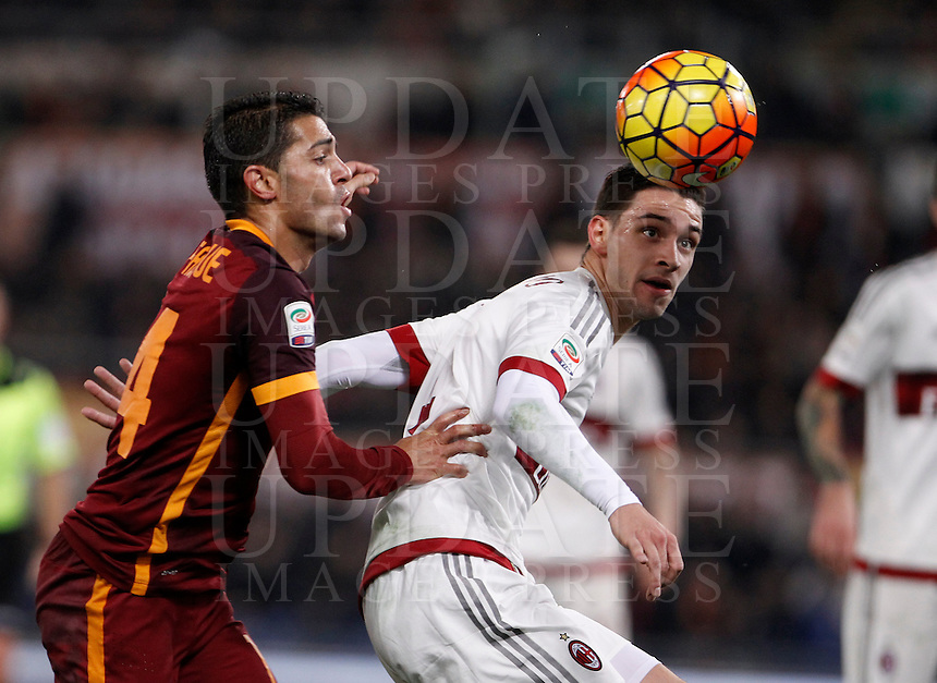 Calcio, Serie A: Roma vs Milan. Roma, stadio Olimpico, 9 gennaio 2016.<br /> Roma's Iago Falque, left, and AC Milan's Mattia De Sciglio fight for the ball during the Italian Serie A football match between Roma and Milan at Rome's Olympic stadium, 9 January 2016.<br /> UPDATE IMAGES PRESS/Isabella Bonotto