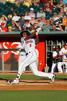 Lansing Lugnuts outfielder Reggie Pruitt (5) follows through on a swing during a game against the Dayton Dragons at Cooley Law School Stadium on August 10, 2018 in Lansing, Michigan. Lansing defeated Dayton 11-4.  (Robert Gurganus/Four Seam Images)