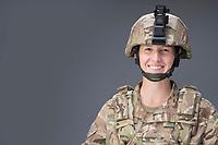 Woman in uniform. model-released, Army OCP or USAF ABU, solo studio portrait