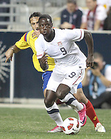Eddie Johnson #9 of the USA MNT pushes away from Mario Yepes #3 of Colombia during an international friendly match at PPL Park, on October 12 2010 in Chester, PA. The game ended in a 0-0 tie.