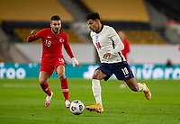 13th October 2020; Molineux Stadium, Wolverhampton, West Midlands, England; UEFA Under 21 European Championship Qualifiers, Group Three, England Under 21 versus Turkey Under 21; James Justin of England running with the ball at his feet watched by Ogulcan Ulgun of Turkey