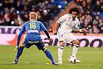 Real Madrid's Marcelo and Celta de Vigo's Daniel Wass during Copa del Rey match between Real Madrid and Celta de Vigo at Santiago Bernabeu Stadium in Madrid, Spain. January 18, 2017. (ALTERPHOTOS/BorjaB.Hojas)