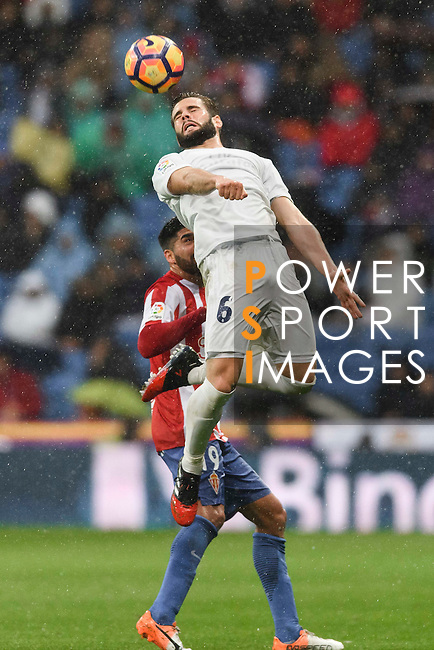 Nacho of Real Madrid battles for the ball with Carlos Carmona Bonet of Real Sporting de Gijon during the La Liga match between Real Madrid and Real Sporting de Gijon at the Santiago Bernabeu Stadium on 26 November 2016 in Madrid, Spain. Photo by Diego Gonzalez Souto / Power Sport Images