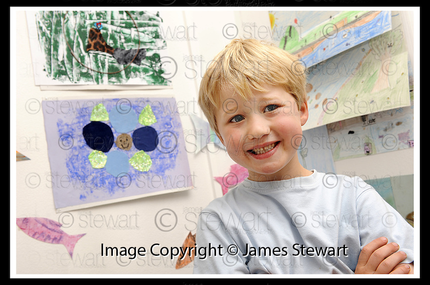 22/06/2009  Copyright  Pic : James Stewart.24_cross_currents.DELTA STUDIOS :: CROSS CURRENTS EXHIBITION :: RYAN BENNETT (5), CARRON PRIMARY, WITH ONE OF HIS PAINTINGS :: .James Stewart Photography 19 Carronlea Drive, Falkirk. FK2 8DN      Vat Reg No. 607 6932 25.Telephone      : +44 (0)1324 570291 .Mobile              : +44 (0)7721 416997.E-mail  :  jim@jspa.co.uk.If you require further information then contact Jim Stewart on any of the numbers above.........