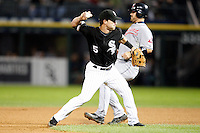 August 7, 2009:  Second Baseman Jayson Nix (5) of the Chicago White Sox attempts to turn a double play in front of Kelly Shoppach during a game vs. the Cleveland Indians at U.S. Cellular Field in Chicago, IL.  The Indians defeated the White Sox 6-2.  Photo By Mike Janes/Four Seam Images
