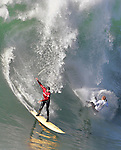Ryan Seelbach (red) and Evan Slater share on wave in the semi finals of Mavericks near Half Moon Bay, California.