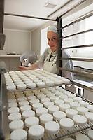 Europe/Europe/France/Midi-Pyrénées/46/Lot/Loubressac: Ferme Cazal-SARL Les Alpines - Production du Rocamadour AOC Fermier - les fromages frais moulés vont  partir sur des grilles pour l'affinage  // France, Lot, Loubressac, labelled Les Plus Beaux Villages de France (The Most Beautiful Villages of France), Cazal Farm-Ltd The Alpine, Production of Rocamadour AOC Farmer, fresh cheeses are molded from wire racks for refining<br />  - Auto N°: 2010-103