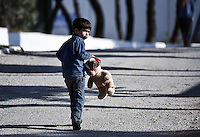 Pictured: A child plays at the camp Friday 26 February 2016<br /> Re: Hundreds of refugees have been given temporary shelter at the Stefanakis Army Camp in the Schisto area of Athens, Greece.
