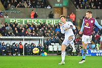 Pictured: Friday 26 December 2014<br /> Re: Premier League, Swansea City FC v Aston Villa at the Liberty Stadium, Swansea, south Wales, UK.<br /> <br /> Swansea's Tom Carroll on the ball