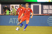 EAST RUTHERFORD, NJ - SEPTEMBER 7: Walker Zimmerman #4 of the United States kicks the ball during a game between Mexico and USMNT at MetLife Stadium on September 6, 2019 in East Rutherford, New Jersey.