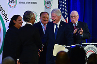 Washington, DC - January 20, 2020:  Former U.S. President Bill Clinton greets Rev. Al Shrpton and others before he speaks during a breakfast hosted by the National Action Network honoring the legacy of Dr. Martin Luther King, Jr on MLK Day, January 20, 2020 at the Mayflower Hotel in Washington, DC.  (Photo by Don Baxter/Media Images International)
