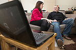 © Joel Goodman - 07973 332324 .  04/02/2014 . Sale , UK . Rachel Reeves talks to Tony Gunning in his flat . Rachel Reeves , MP for Leeds West and Shadow Secretary of State for Work and Pensions and Chris Bryant , MP for Rhondda and Shadow Minister for Welfare Reform , join Labour candidate Mike Kane on the campaign trail ahead of the Wythenshawe and Sale East by-election , following the death of MP Paul Goggins . They visit the home of Tony Gunning (51) who suffers from hereditary adult polycystic kidney disease and is on dialysis , who says he is affected by the bedroom tax . Photo credit : Joel Goodman