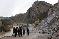 "A construction team conducts maintenance on a road on the Tibetan Plateau. Construction in the region is increasing rapidly as the government implements its ""western development strategy,"" aimed at bringing prosperity to the region. The Tibetan Plateau is a fragile ecosystem and changes here will have far-reaching implications for all of Asia."