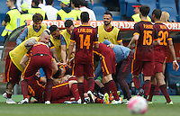 Calcio, Serie A: Lazio vs Roma. Roma, stadio Olimpico, 3 aprile 2016.<br /> Roma's Alessandro Florenzi is hidden by teammates' hugs after scoring during the Italian Serie A football match between Lazio and Roma at Rome's Olympic stadium, 3 April 2016.<br /> UPDATE IMAGES PRESS/Riccardo De Luca