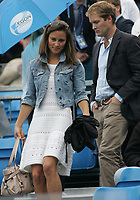 LONDON, ENGLAND - JUNE 09: Pippa Middleton with George Percy leaves centre court as rain delays play during the Men's Singles third round match between Andy Roddick of the United States and Kevin Anderson of South Africa on day four of the AEGON Championships at Queens Club.  Now that Pippa Middleton has parted from her banker boyfriend, handsome former cricketer Alex Loudon, the arduous task of consoling Her Royal Hotness appears to have fallen to an extremely eligible young bachelor: one George Percy.  on June 9, 2011 in London, England<br /> <br /> People:  Pippa Middleton_George Percy