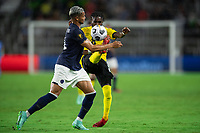 ORLANDO, FL - JULY 20: Oniel Fisher #8 of Jamaica kicks the ball during a game between Costa Rica and Jamaica at Exploria Stadium on July 20, 2021 in Orlando, Florida.