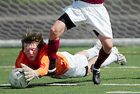 Ames goalkeeper Michael Schmidt beats Dowling Catholic forward Jackson Teeling to the ball during their quarterfinal match in the Class 3A state soccer tournament on June 4, 2009 at Southeast Polk High School.