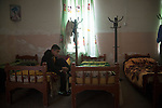 16/11/14. Alqosh, Iraq. Wassam puts on his socks as he gets up in the morning.