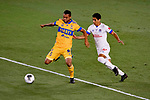 Rafael Carioca of Tigres UANL (MEX) fights for the ball against Carlos Pineda of CD Olimpia (HON) during their CONCACAF Champions League Semi Finals match at the Orlando's Exploria Stadium on 19 December 2020, in Florida, USA. Photo by Victor Fraile / Power Sport Images