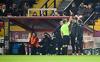 Lincoln City's first team coach/under 23 manager Jamie McCombe is shown a yellow card by referee John Brooks<br /> <br /> Photographer Chris Vaughan/CameraSport<br /> <br /> The EFL Sky Bet League Two - Lincoln City v Exeter City - Tuesday 26th February 2019 - Sincil Bank - Lincoln<br /> <br /> World Copyright © 2019 CameraSport. All rights reserved. 43 Linden Ave. Countesthorpe. Leicester. England. LE8 5PG - Tel: +44 (0) 116 277 4147 - admin@camerasport.com - www.camerasport.com
