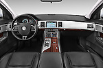 Stock photo of straight dashboard view of a 2015 Jaguar XF 2.2D 163 auto 4 Door Sedan 2WD Dashboard