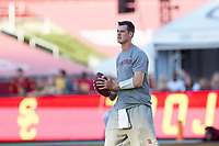 LOS ANGELES, CA - SEPTEMBER 11: Tanner McKee #18 of the Stanford Cardinal warms up before a game between University of Southern California and Stanford Football at Los Angeles Memorial Coliseum on September 11, 2021 in Los Angeles, California.