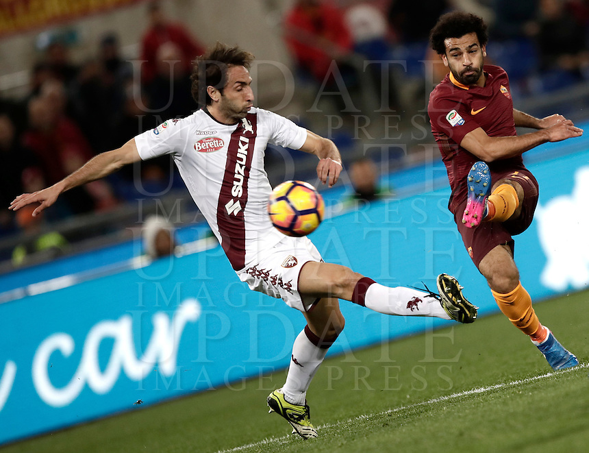 Calcio, Serie A: Roma, stadio Olimpico, 19 febbraio 2017.<br /> Roma's Mohamed Salah (r) in action with Torino's Emiliano Moretti (l) during the Italian Serie A football match between As Roma and Torino at Rome's Olympic stadium, on February 19, 2017.<br /> UPDATE IMAGES PRESS/Isabella Bonotto