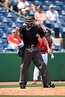 Home plate umpire Mike Wiseman makes a call during a game between the Clearwater Threshers and Dunedin Blue Jays on April 6, 2014 at Bright House Field in Clearwater, Florida.  Dunedin defeated Clearwater 5-2.  (Mike Janes/Four Seam Images)