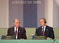 April 22,  2001, Montreal, Quebec, Canada<br />  US president George W, Bush (R)  listen while <br /> Argentina President Fernando De La Rua (L) speak at the closing press conference of the Summit of the Americas , April 22, 2001 in Quebec City, CANADA.