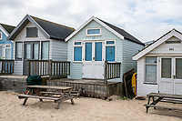 BNPS.co.uk (01202 558833)<br /> Pic: MaxWillcock/BNPS<br /> <br /> With video: https://youtu.be/YhZrWp9eNF4<br /> <br /> Pictured: The beach hut for sale (centre).<br /> <br /> The prices of Britain's most expensive beach huts are on course to break through the £400,000 barrier due to the huge demand for them by rich staycationers. <br /> <br /> The wooden cabins at Mudeford in Christchurch, Dorset, have always commanded premium prices but they are now selling for more than people pay for a four bedroom house in many parts of the country.<br /> <br /> This week a hut went on the market for an asking price of £355,000, just two weeks after one sold within hours of being listed for £350,000.