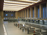 Berlin, Germany- File Photo -<br /> Inside view of the<br /> Tempelhof Airport (THF) is due to close on October 31, 2008.<br /> <br /> Berlin-Tempelhof Airport (IATA: THF, ICAO: EDDI) also known as Tempelhof Airport (German: Flughafen Tempelhof) is an airport in Berlin, Germany, situated in the south-central borough of Tempelhof-Sch??neberg. The airport is commonly known as Tempelhof.<br /> <br /> Designated by the ministry of transport on October 8, 1923, Tempelhof became the world's first airport with an underground railway station in 1927, now called Platz der Luftbr??cke after the Berlin Airlift. While occasionally cited as the world's oldest still-operating commercial airport, Chicago's Midway Airport is the same age, and Sydney Airport in Sydney, Australia, predates it by three years.<br /> <br /> Tempelhof was one of Europe's three iconic pre-war airports — the others being London's old Croydon Airport and Paris Le Bourget. One of the airport's most distinguishing features is its large, canopy-style roof that was able to accommodate most contemporary airliners during its heyday in the 1950s, 1960s and early 1970s, thereby saving passengers from the elements. Tempelhof Airport's main building is the 20th largest building on earth. Tempelhof used to have the world's smallest duty-free shop.[1]<br /> <br /> Tempelhof Airport is due to close on October 31, 2008.