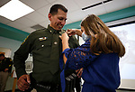 Kyra Gonzales pins a Lieutenant badge on her dad, Daniel Gonzales, during a promotion ceremony at Carson City Sheriff's Office, in Carson City, Nev., on Thursday, July 2, 2020. <br /> Photo by Cathleen Allison